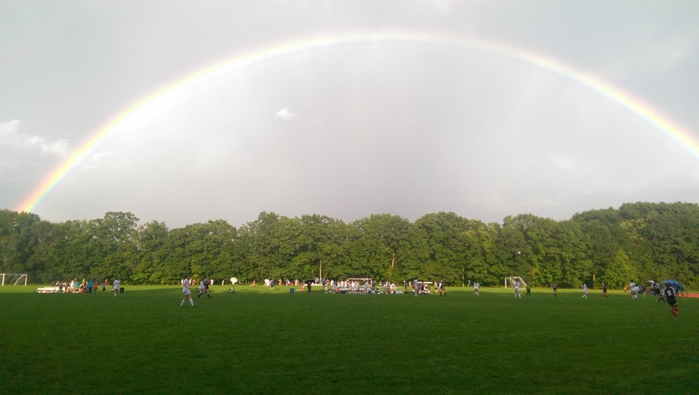 Rainbow over soccer field