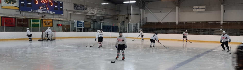 My wife's hockey team warming up at a rink in Saratoga Springs.
