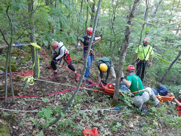 Level 1 students pull a patient up over a cliff