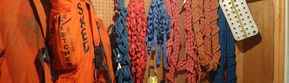Left to right, 2 skeds hanging, and then some rope and webbing.